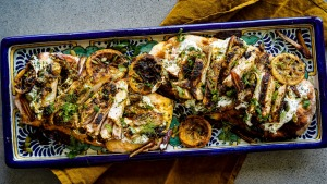 Flatbreads topped with chermoula marinated chicken, charred lemon, dates and tzatziki.