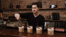 Colin Dahl, founder and chief product scientist of Oppil makes a round of whisky sours at the alcohol brand's Newtown bar.