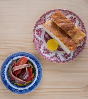 Proud focaccia comes with a selection of condiments such as anchovies and cured tomatoes.