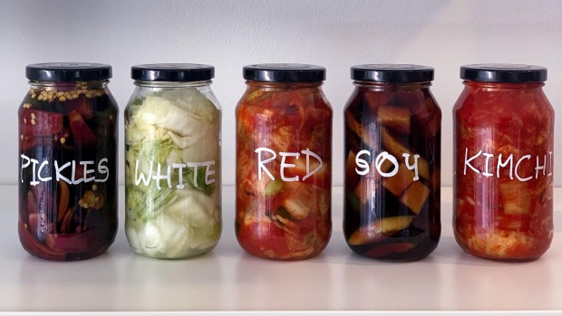 Jars of house-made kimchi and pickles.