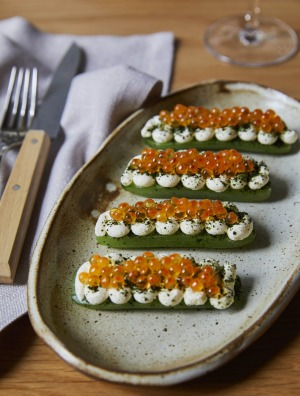Zeitgeisty snacks of cucumber, smoked sour cream and salmon roe at Monopole in Sydney.