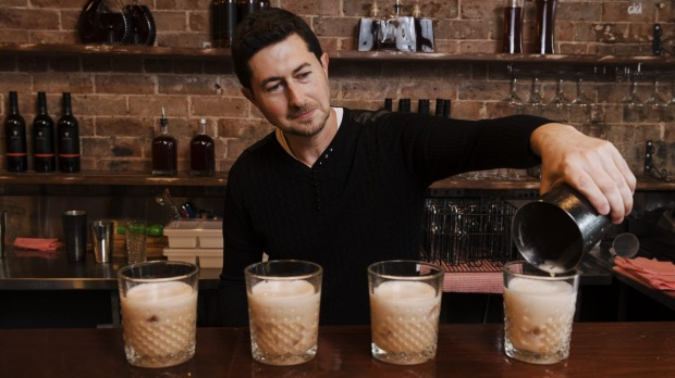 Colin Dahl, founder and chief product scientist of OPPIL, makes a whiskey sour.