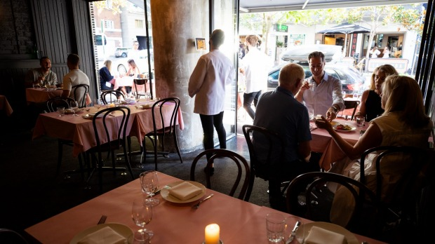 Pink tablecloths adorn the tables at Bistrot 916.