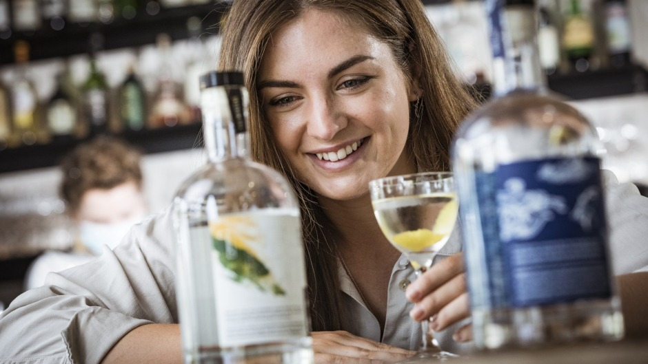 Marika Berney, marketing manager for The Cannabis Company with a martini made with the Myrcene Hemp Gin at The Carlton ...