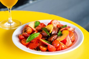 Tomatoes and peaches with tarragon, crispy chilli and fennel seed.
