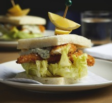 Crumbed fish sandwich with tartare and iceberg at Karen Martini's all-day eatery Hero at ACMI, Federation Square, Melbourne.