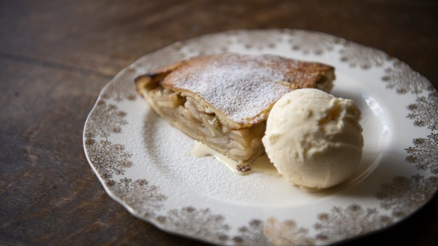 A wedge of Ben's apple pie with vanilla ice-cream.