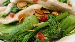 Velvet chicken with fried almonds and broccolini.