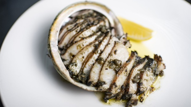 Local black-lip abalone bolstered by a compond butter of oysters, scallops and seaweed at Rockpool Bar and Grill, Sydney.