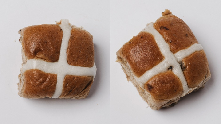 Hot cross buns from Aldi (left) and Woolworths.
