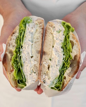Roast chicken with herb mayo, fresh cucumber and oak lettuce on sourdough Turkish bread at Hector's Deli.