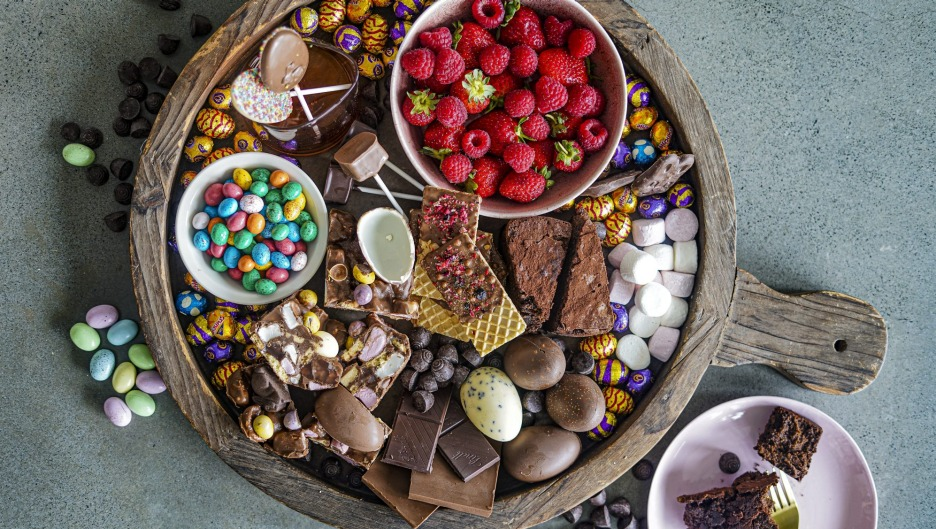 Fresh berries, chocolate-dipped wafers and portions of chocolate cake and rocky road add visual interest to this ...