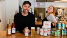 Cameron Walsh, co-owner of Winona bottle shop in Manly, with some of his growing selection of non-alcoholic beer and wine.