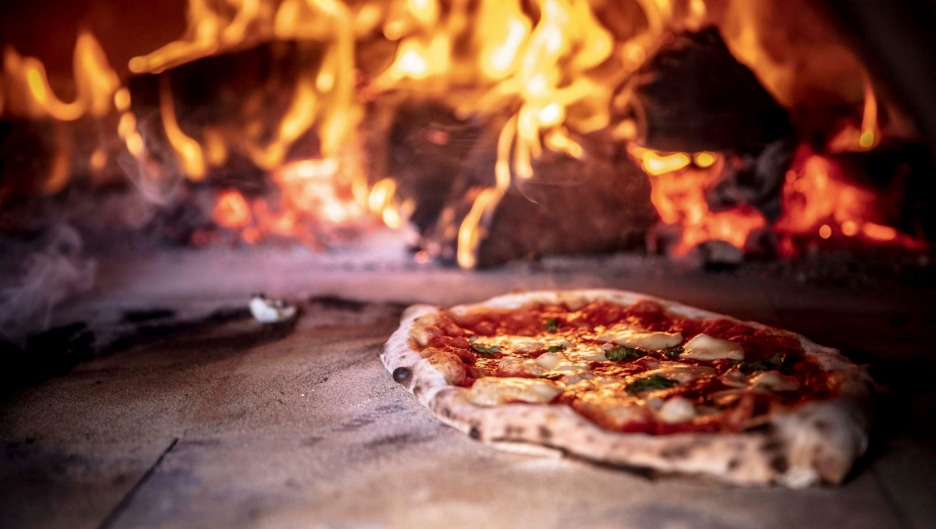 Feeling hot, hot hot: Grossi's simple margherita pizza being cooked in a wood-fired oven.