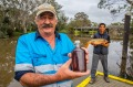 Peter Ingram (left) and Don Enriquez (R) fish the waterways of Gippsland and turn carp into fish sauce.