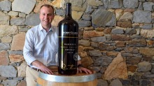 Barossa Grape and Wine Association CEO James March with the 18L single-vineyard Shiraz up for auction during April.