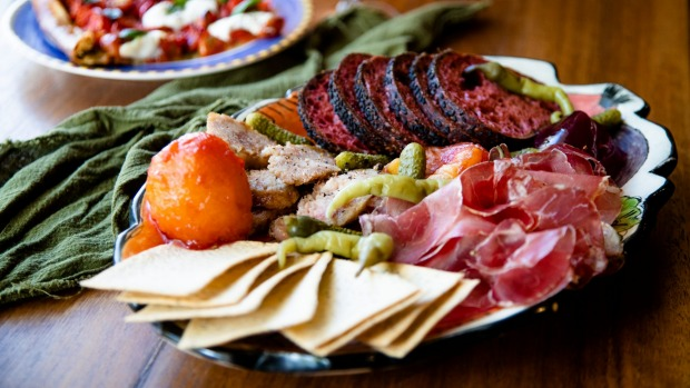 Coppa and butifarra with cornichons, sweet plum paste, crackers and Tonton bread.