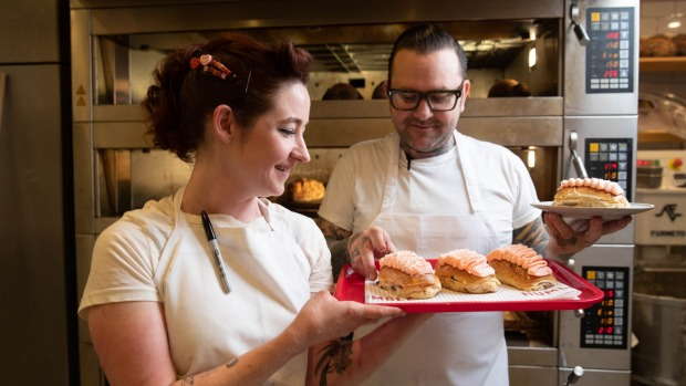 Alyce Bennett and Ben Milgate at Humble Bakery in Surry Hills with their pink finger buns.