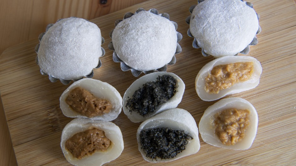 A set of mixed mochi, round and spongy rice desserts.