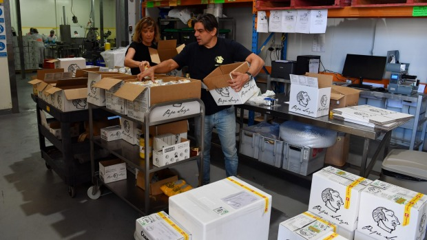 Pepa Saya owner Pierre Issa and partner Melissa Altman pack butter and milk at their warehouse in Caringbah, Sydney.