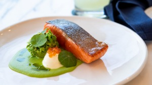 King Ora salmon with a velvety pea veloute and creme fraiche.