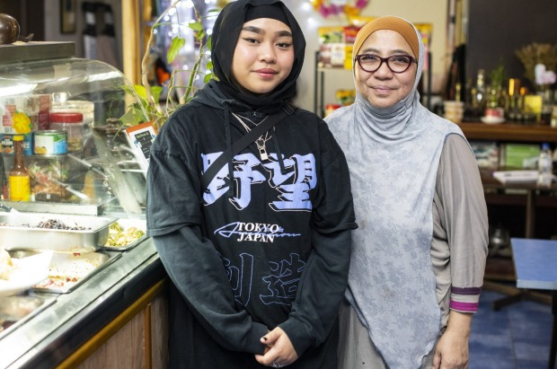Alimah Vilda (left) with her granddaughter Amalul Binte from Island Dreams Cafe in Lakemba.