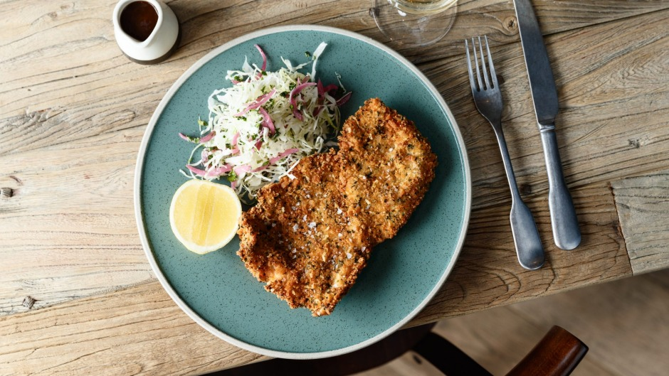 Parmesan-and-herb-crumbed chicken schnitzel.