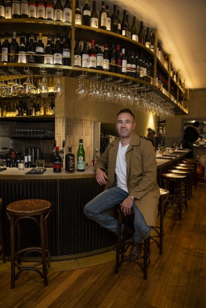 Ragazzi co-owner Nathanial Hatwell with a few of his favourite amaro bottles on the bar.