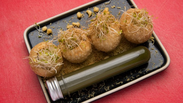 """Pani puri served with a test tube of coriander, mint and green chilli """"water""""."""