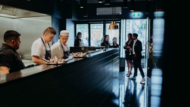 Ekeko'sentrance is dominated by a high-energy open kitchen.