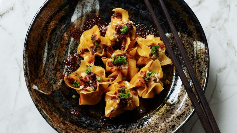 Serve the steamed dumplings with chilli oil and chopped chives.