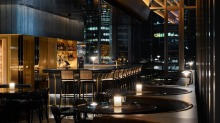 The space has black leather banquettes and a black and gold colour palette.