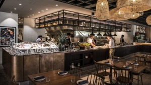 Chef Jay Lao works the charcoal grill in Ruse's very open kitchen.