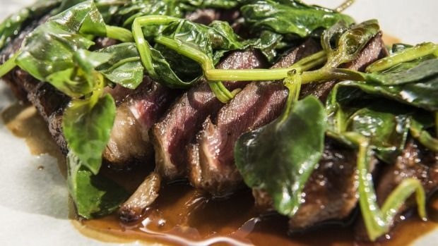 Scotch fillet with spinach and warrigal greens.