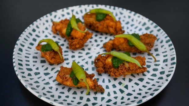 Deep-fried chicken ribs with chimichurri and guindilla peppers.