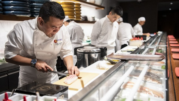 Chefs at the sushi counter at Nobu, Crown Sydney.