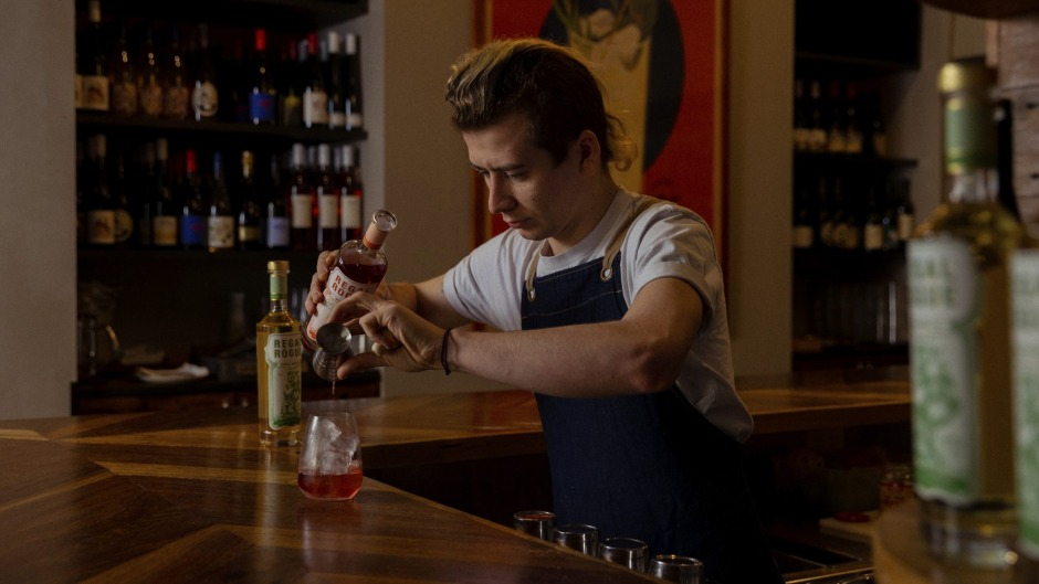Dead Ringer bar manager Dominic Causley-Todd serves Regal Rogue vermouth over ice in Surry Hills, Sydney.