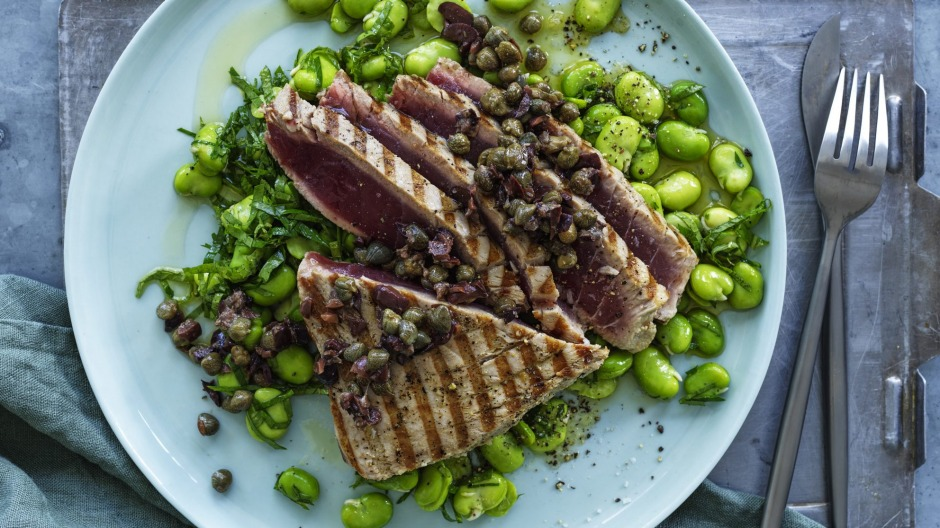 Barbecued tuna steaks with broad beans and roughly chopped  tapenade.