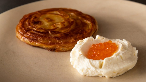 Malawach, a flaky Yemenite pastry, with house-made buttermilk ricotta and trout roe.