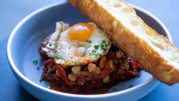 Parsley and pecorino sausages from LP's Quality Meats, with fried egg and chickpea peperonata.