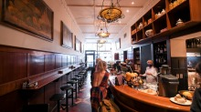 Handsome timber panelling and gold-framed paintings decorate the Grossi family's Cellar Bar.