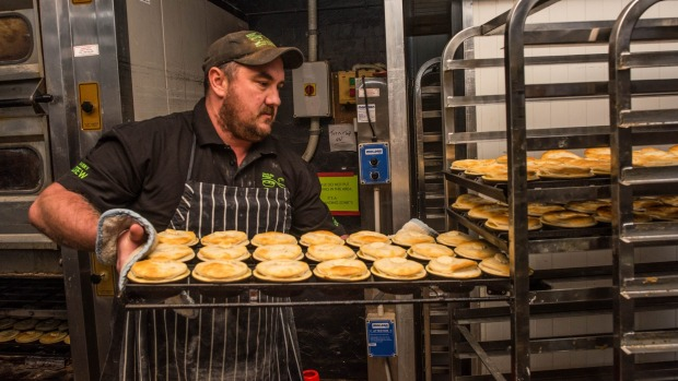 Apollo Bay Bakery's head baker, James Crump, with the first batch of Victorian scallop pies.