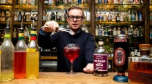Bar owner Mikey Enright makes a cocktail with grape-based gin at the Barber Shop in Sydney.