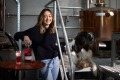 Bass & Flinders distiller Holly Klintworth with her dog Gilbert and pinot-infused gin.