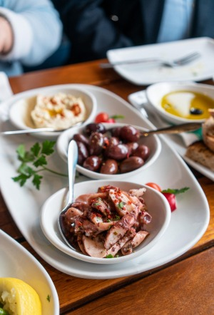 Marinated olives and octopus as part of a Greek feast at Mythos in Oakleigh.