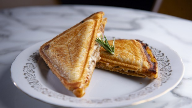 Spicy lamb jaffle, plump with slow-cooked meat, chilli tomato, and melting goat's cheese.