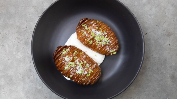Hasselback potatoes roasted with beef fat and served with labne.