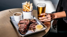 New shine: Black Angus T-bone with diane sauce and chips.