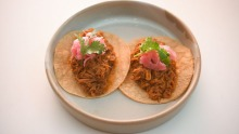 Pork tacos come in pairs.