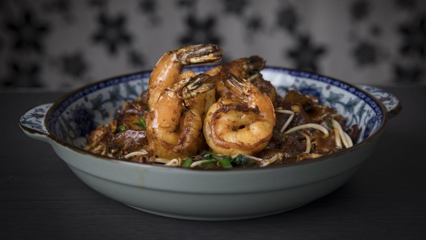 The prawn char kwai teow is tossed over high heat until smoky and soy-blackened.